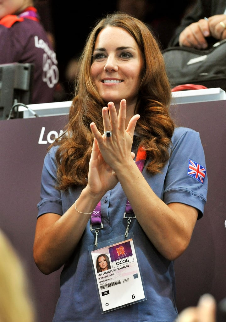Kate Middleton was out in London again for day nine of the Olympic Games today. She watched the artistic gymnastics competition solo, after having Prince William by her side yesterday at a track event. Kate then moved on to the stands at a handball match wearing a light-blue polo shirt.  It was a busy week for Kate and William, who attended multiple events and even showed some PDA in the stands. Prince Harry has also been out supporting Team GB, though he took a break from the sports action to suit up for a special reception on Thursday.