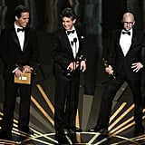 Screenwriters Nat Faxon, Alexander Payne and Jim Rash accept the Best Adapted Screenplay Award for The Descendants, and poked fun at Angelina's sexy pose.