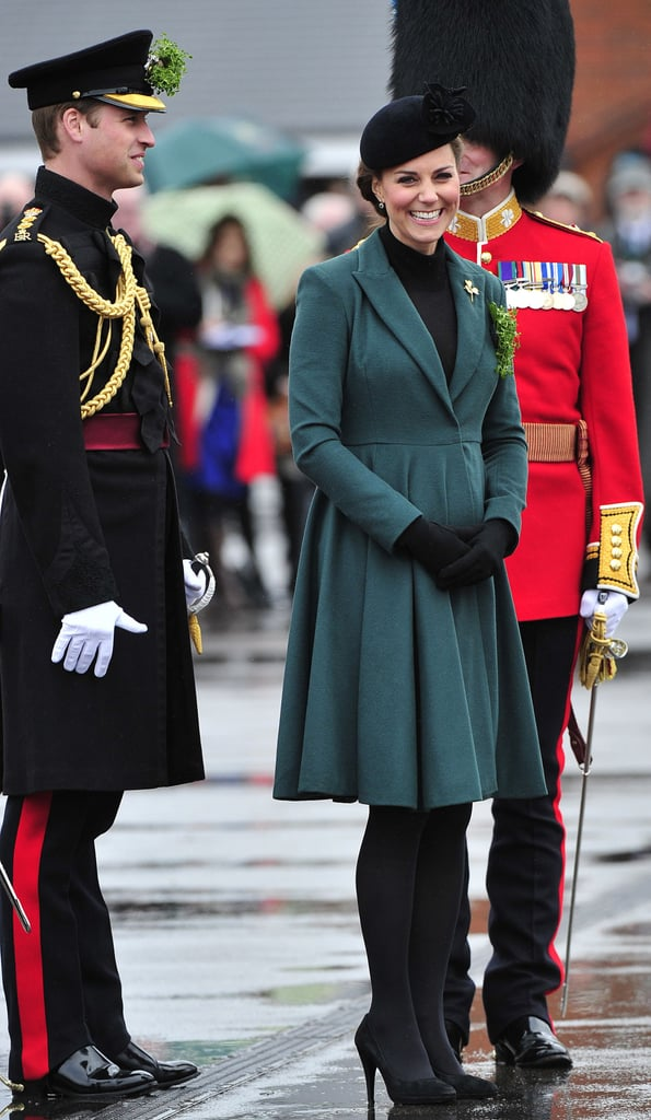 She looked the part of supportive wife and festive St. Patrick's Day-goer in a green coat.