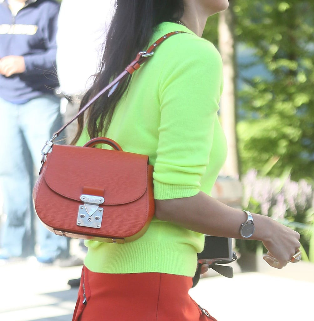 How awesome did this bag look playing off of a bold, neon top? Source: Greg Kessler