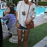 Jacey Duprie worked her neutral-print Creatures of Comfort top with pom-pom-embellished Pac Sun shorts, a neutral YSL bag, and metallic sliders from J.Crew.