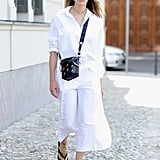 In All White With Flip-Flops
