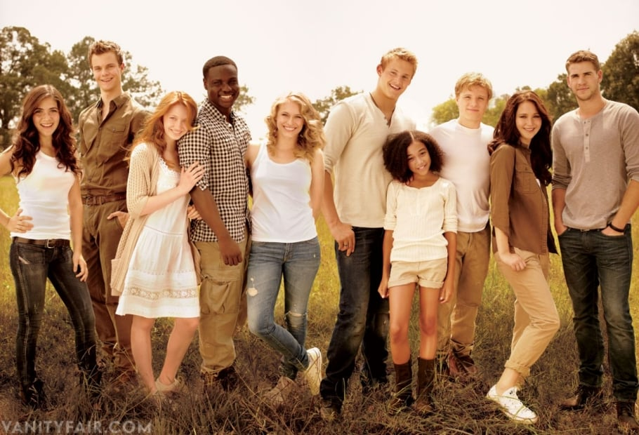 """The cast of The Hunger Games posed in the Vanity Fair Dec. issue with Scarlett Johansson on the cover while on set in North Carolina. Stars Josh Hutcherson, Jennifer Lawrence, and Liam Hemsworth were in earth tones alongside Isabelle Fuhrman, Jack Quaid, Jacqueline Emerson, Dayo Okeniyi, Leven Rambin, Alexander Ludwig, and Amandla Stenberg. The first movie in the blockbuster trilogy won't be out until next year, but fans of the series are already excited. Jennifer shared her thoughts on her role of Katniss with the magazine. She said, """"Katniss is an incredible character: she's a hunter but not a killer, a 16-year-old who's being forced into the arena. These kids are killing one another only because if they don't they'll die. It's heartbreaking."""" It wasn't all work and no play while they filmed the picture, which involved lots of fight scenes, dirt, and generally rough conditions. Josh added to Vanity Fair, """"Jennifer and I totally hit it off. We're both crazy people — we don't hold anything back."""" Sam Jones exclusively for Vanity Fair"""