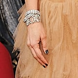 Kristen Wiig played up the glamour with an armful of diamonds.