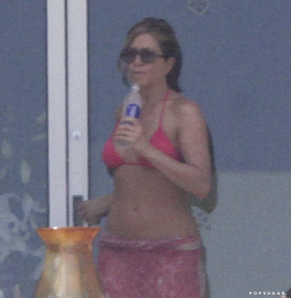 Jennifer Aniston walked around her patio.