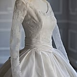 Sheer sleeves were attached to the bodice, featuring ivory embroidery that matched the gown's full skirt.