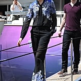 Karolina Kurkova boarded a yacht looking fashionable in a printed tie blouse with matching wide-leg trousers, complete with crisp white pumps and cool sunglasses.
