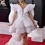 Wearing an angelic Ashi dress and Christian Louboutin heels to the Grammys.