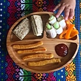 """""""Lunch: whole grain-and-seed bread with white cheddar, cucumber wrapped in turkey, orange bell peppers, and sweet potato and carrot fries with ketchup."""""""