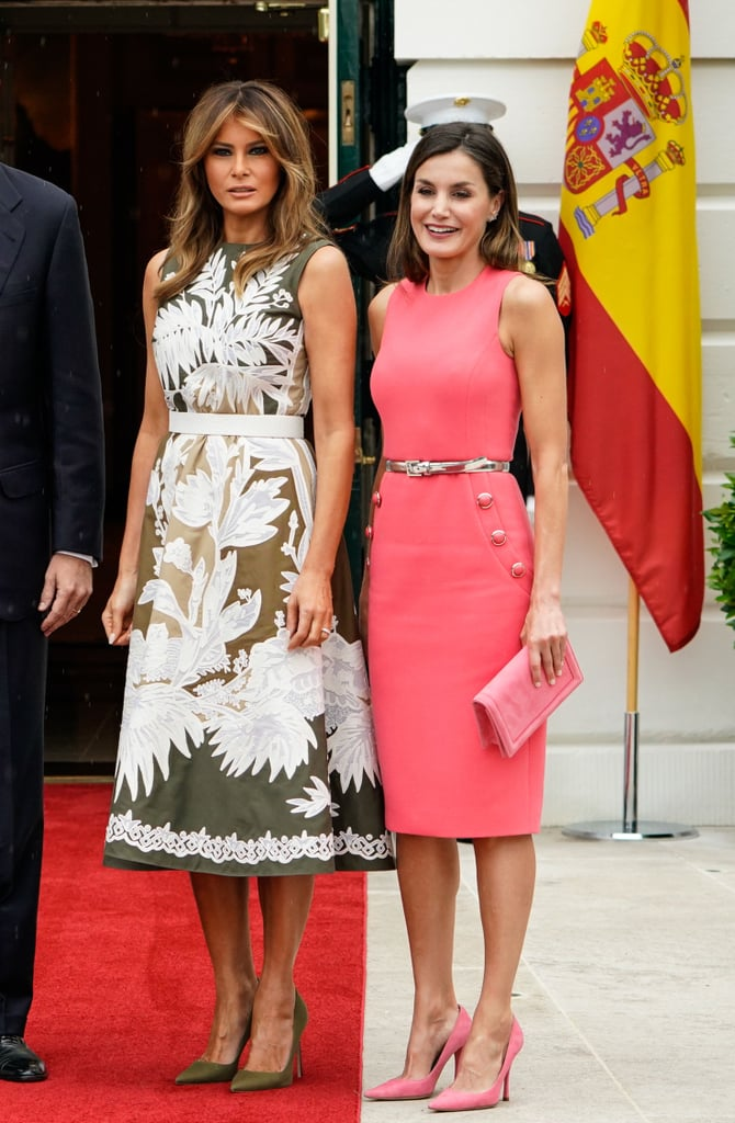 After her recent public reemergence, Melania Trump met with King Felipe VI and Queen Letizia of Spain at the White House, and we couldn't help but wonder . . . have we seen Queen Letizia's dress before? Why, yes, we have.    The 45-year-old royal wore a sleeveless pink Michael Kors dress ($1,695), complete with buttons on the sides, that's the fraternal twin to a certain powder-blue number hanging in Melania's closet. FLOTUS wore the same dress in a different shade last Summer, when she met Panama's president and first lady. Letizia may have taken a nod from Melania's wardrobe, but she made the outfit her own, not only in her color choice, but by cinching the waist with a metallic silver belt.  Melania opted for an olive green Valentino dress with an ombré effect and matching Manolo Blahnik heels for this visit. Ahead, take a peek at the duo's meeting and see exactly how they styled their outfits, then shop similar versions of the Michael Kors sheath that's been approved by both women.