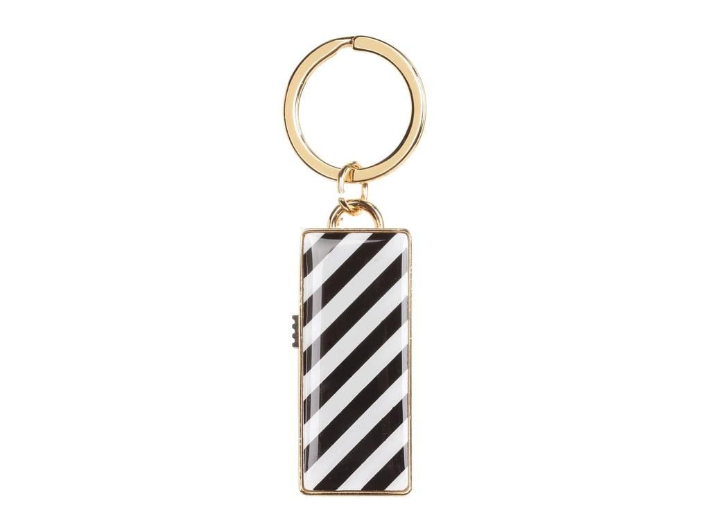Inspire a good work ethic. This striped Kate Spade New York USB key chain ($50) is so nice to look at, they'll want to bring files home from the office.