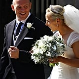 Mike Tindall smiles lovingly at his bride, Zara Phillips.