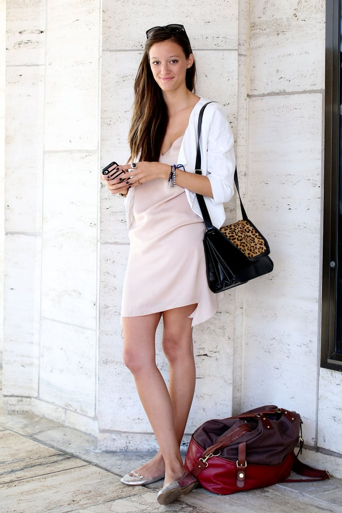 A silky pink dress and breezy white blazer met a Fall-feeling leopard satchel.