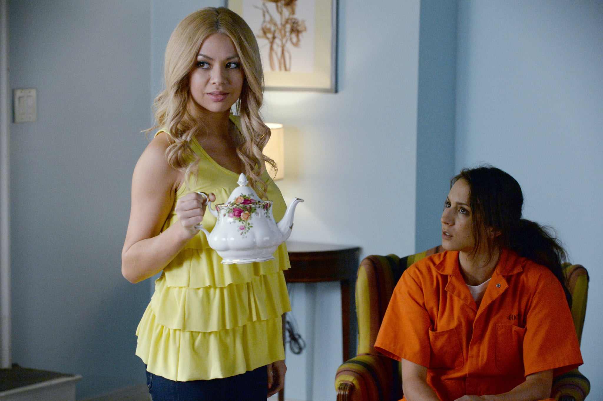 PRETTY LITTLE LIARS, l-r: Janel Parrish, Troian Bellisario in 'Welcome to the Dollhouse' (Season 5, Episode 25, aired March 24, 2015). ph: Eric McCandless/ABC Family/courtesy Everett Collection