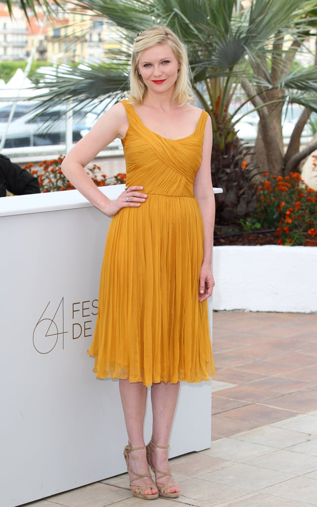 Kirsten went for bright and bold in a saffron-hued Chloe dress and nude strappy Jimmy Choo sandals for the Melancholia photocall in Cannes.