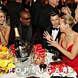 Paige Butcher, Eddie Murphy, Colin Jost, and Scarlett Johansson at the 2020 Golden Globes