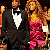 Beyoncé and Jay Z dressed up for the Keep a Child Alive gala in NYC in September 2010. Jay kept it classic in a black tuxedo, while Beyoncé chose a bright, draped fuchsia dress.
