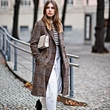 On cooler days, layer a checked coat over stripes and white pants.