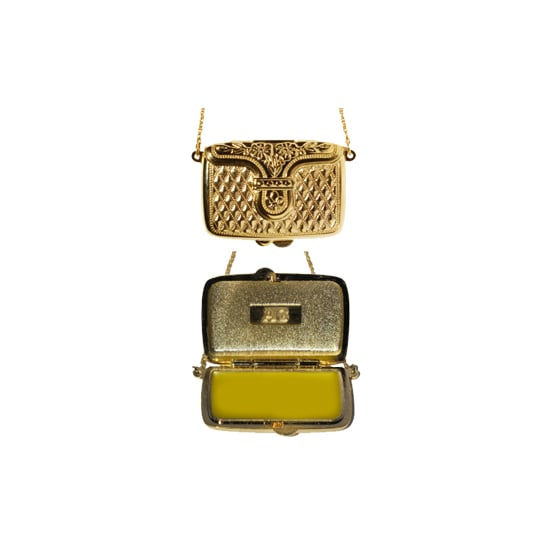 "If she's addicted to handbags, Andrea Garland's lip balm necklace ($46) is the perfect stocking stuffer. Inside the ""purse"" is a lip balm made with all-natural ingredients such as shea butter and lavender. Package it in a pretty box, and it'll seem more expensive than it really is."