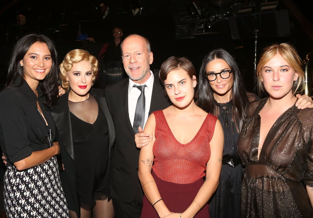 """Rumer Willis had her whole family on hand to celebrate her Broadway debut as Roxie Hart in Chicago on Monday night. Her parents, Bruce Willis and Demi Moore, who split in 2000 and have since remained friendly, were there along with Bruce's current wife of six years, Emma Heming. Rumer's sisters Scout and Tallulah made appearances as well and even showed their support on social media when Tallulah posted a snap in front of the theater with the caption, """"SO F*CKING PROUD OF YOU!"""" Rumer returned the love in a sweet post and captioned the photo of her whole family: """"These people are everything to me. I would never had made it to that stage without you guys. Thank you to my amazing parents for supporting me my whole life and thru all my crazy ideas and adventures and pushing me to be the best version of myself and to my sisters for being my partners in crime, my confidants and for always letting me be my goofy unabashed self. I love you all.""""           View this post on Instagram            A post shared by tallulah (@buuski)"""