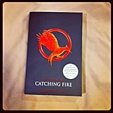 Now that the trailer has been released, POPSUGAR celebrity and entertainment editor Jess is brushing up on the original version of Catching Fire.