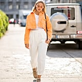 Wear white high-waisted pants with confidence — then add in a boxy cropped jacket in a bright colour to take them to the next level.
