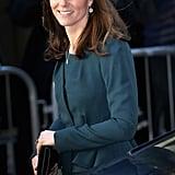Kate's diamond drop earrings played up her glow.