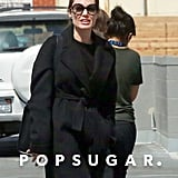 Angelina Jolie Wearing Black Trousers