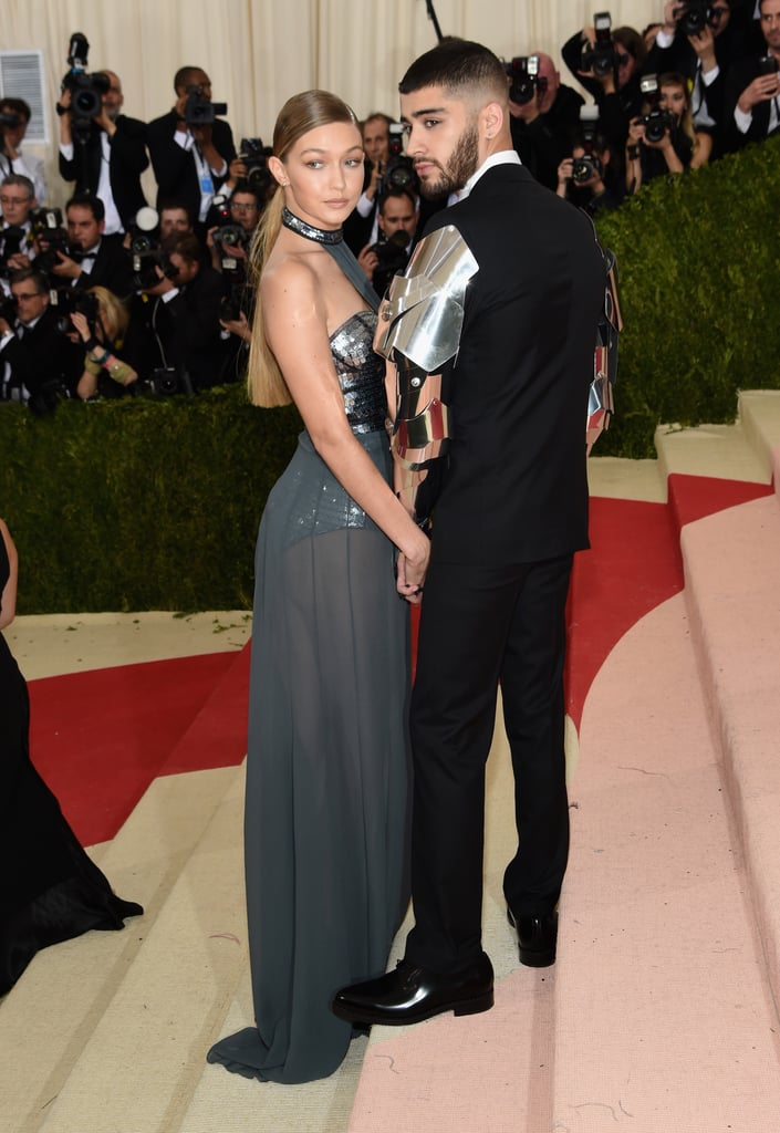 Gigi Hadid and Zayn Malik made their first-ever red carpet appearance together at the 2016 Met Gala. The picture-perfect pair, who posed together for a stunning spread in Vogue's May issue, walked the red carpet together for the big night. Gigi stunned in a floor-length gown and Zayn rocked armor-like sleeves, fully channeling the night's theme: Manus x Machina: Fashion in an Age of Technology.  The couple's stylish date night comes on the heels of Gigi's 21st birthday, which included some time with her family, a night out in LA with friends, plus a big celebration in Vegas. Keep reading to see the best pictures of Gigi Hadid and Zayn Malik's Met Gala appearance, then check out all the Met Gala looks!