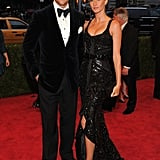 Gisele Bundchen posed holding hands with husband Tom Brady on the red carpet of the Met Gala.