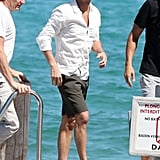 Ryan Seacrest wore shorts and a hat for his vacation.
