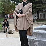 This styler topped it off with a khaki cape to lend a chic finish.