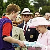 The queen presented her grandson Prince Harry with an award during the Royal Ascot in 2003.