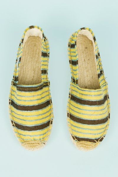We're smitten with these lemony-yellow espadrille flats.  Opening Ceremony x Soludos Striped Espadrilles ($40)