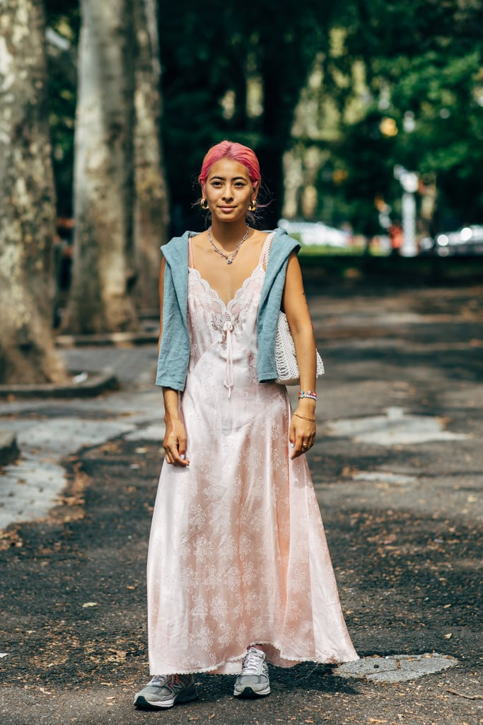 Finish a romantic slip dress with cool sneakers.