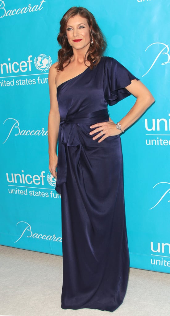 Kate Walsh in a navy silk dress.