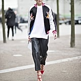 At London Fashion Week, Olivia threw the Topshop bomber over a white sweater and leather culottes for a cool-girl twist.