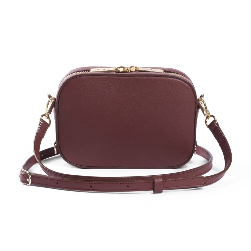 """Small crossbody bags always come in handy, but this cognac camera option from Pop & Suki ($195) — aka Suki Waterhouse's new line — lets you write your name on the bottom. Umm . . . get in my closet!"" — SS"
