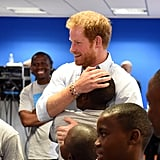 Harry embraced a young student after watching members of the Basotho Youth Choir rehearse in 2016.