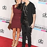 Justin Bieber stood next to his mom.