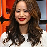 Going for a classic holiday look in a Winter-white top, Jamie Chung mastered the matte red lip and tousled waves.