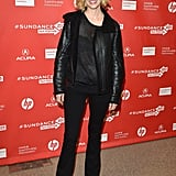 January Jones mixed trends in a sheer sweater, flared denim, and a leather jacket at the Sweetwater premiere.