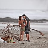 Gisele Bundchen and Tom Brady kissed on the sand.