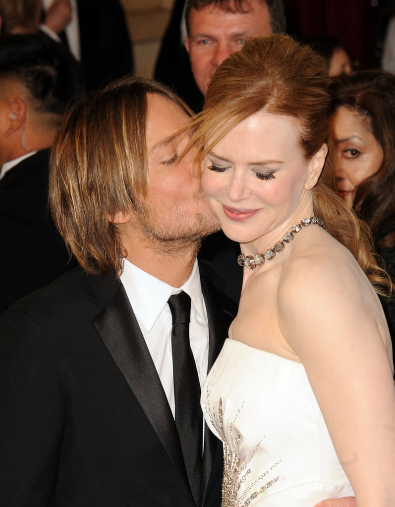 Keith planted a peck on his lady's cheek at the Oscars in February 2011.