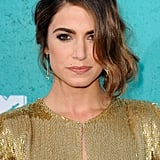Nikki Reed wore a gold dress to the MTV Movie Awards.