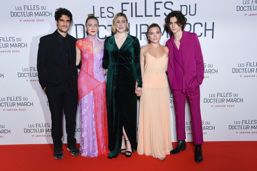 If the Little Women world premiere in New York City on Dec. 7 made us wish we were a March sister, then the red carpet in Paris last night had us on our knees, begging to get in on the fun.  While Emma Watson, Laura Dern, and Eliza Scanlen didn't appear in Paris on Thursday, Louis Garrel, Saoirse Ronan, Greta Gerwig, Florence Pugh, and  Timothée Chalamet all walked the red carpet together, laughing as they posed for cameras. It's clear that the Little Women cast has become great friends while shooting the film. Similar to the premiere in New York, they all held hands and made jokes as they walked the red carpet on Thursday evening in Paris, and seriously, how can we become their friend? Keep on reading to see all our favourite pictures from last night's premiere.