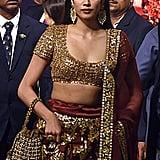 Bollywood Actress Janhvi Kapoor Wore a Red and Gold Abu Jani Sandeep Khosla Lehenga