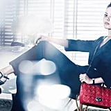 Mila Kunis shows off a pretty red Dior bag. Source: Fashion Gone Rogue