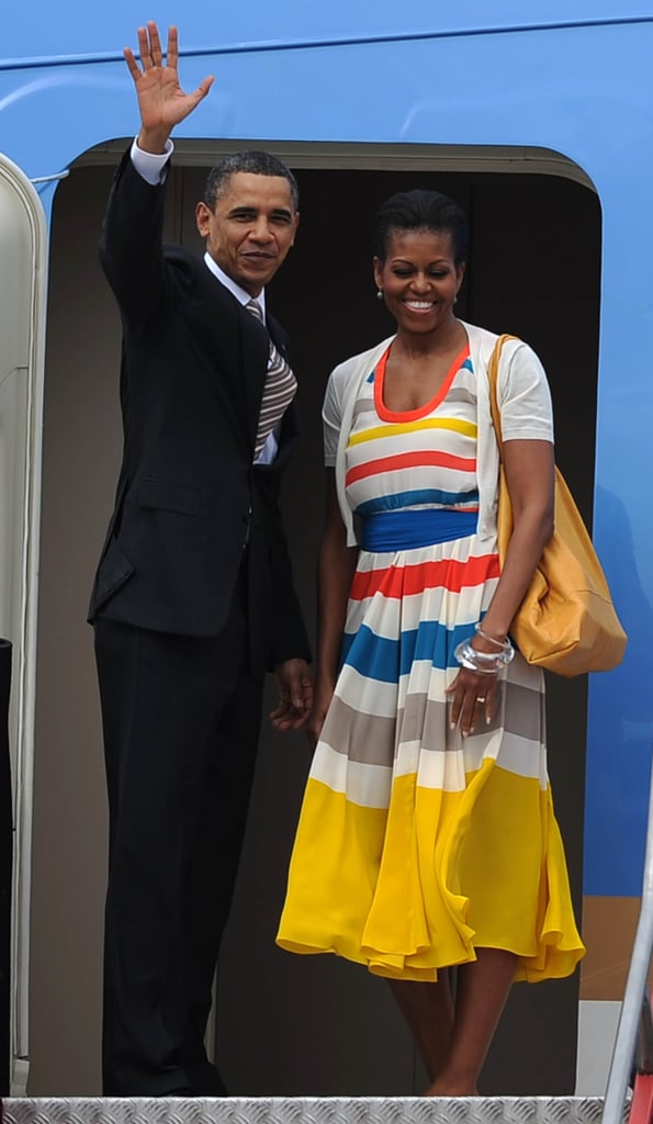 Michelle wearing a bold striped fit-and-flare with a short sleeve cardigan in Brazil.