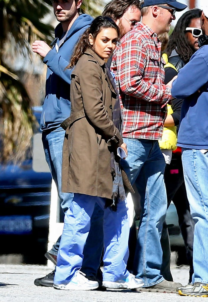 Mila Kunis wore a coat over her scrubs while shooting in LA on Wednesday.